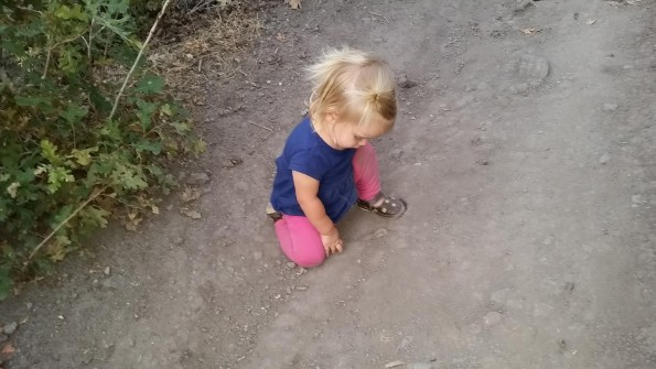 Maeli rubbing her knees on the trail.